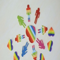 Rainbow Gay Pride male and female figures on wood background. Stock Footage