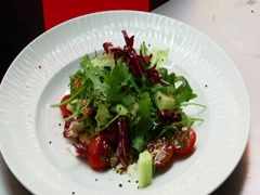 A beautiful dish with lettuce and tomato. Culinary arts Stock Footage