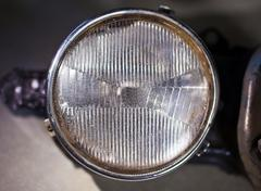 Closeup photo of old car headlight. Stock Photos