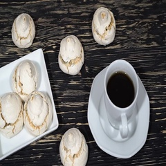 Lot of white meringue cakes with coffee Stock Footage