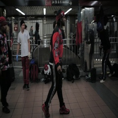 Street dancers performing a dance step at underground station Arkistovideo