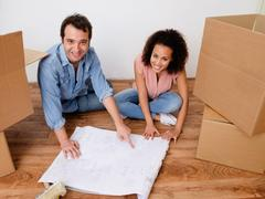 Young interracial couple ready for home relocation Stock Photos