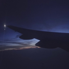 View of clouds, lightening rain from aircraft window in a bumpy ride. Stock Footage