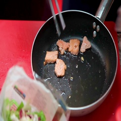 The chef puts out of the frying pan ready pieces of meat. Fried meat. Culinary Stock Footage