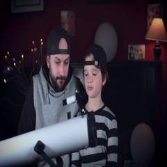 4k Family Home Shot of Child with Dad Looking through Telescope Stock Footage