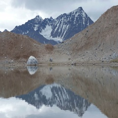 Snowy Mountain reflected in the lake of Spitsbergen Norway Stock Footage