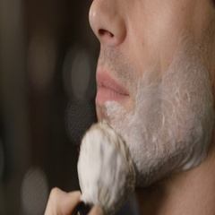 4K Close up of man being prepared for a traditional shave in barber shop Stock Footage