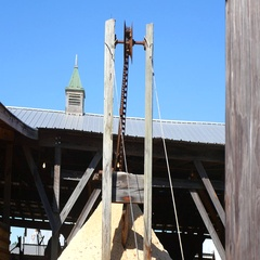 High Chain And Pulley In Front Of A Sawmill Stock Footage