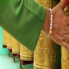 Man's hand rotating holy tibetan prayer wheels Stock Footage