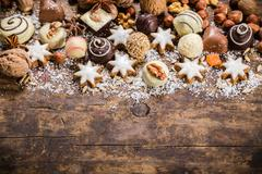 Wooden background with sweets and chocolate Stock Photos