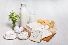 Milk and food on wooden background Stock Photos