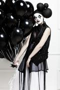 Mime stylized photo of a young beautiful woman Stock Photos
