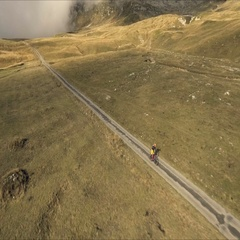 Aerial shot of mountain biker riding the trail Stock Footage