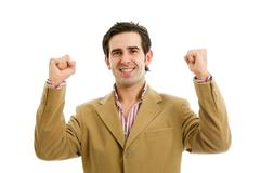 Happy young man winning with open arms, isolated Stock Photos