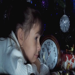 Child with clock under the tree awaiting the offensive magic Stock Footage