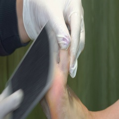 Pedicure procedure in the beauty salon. emover calluses on the feet. Stock Footage