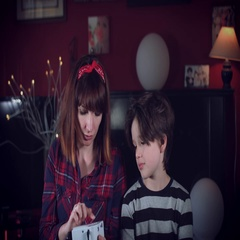 4k Family Home Shot of Child with his Mom Looking at a Video Projector Stock Footage