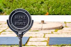 Sign demanding respect next to the Eternal Flame at the Arlington National Cemet Stock Photos