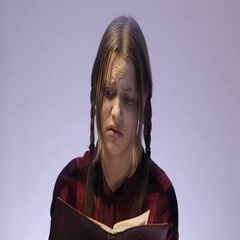 Irritated teen girl reading book about something disgusting. 4K UHD Stock Footage