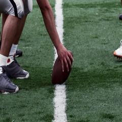 A Quarterback calls the play from the line of scrimmage. Stock Footage
