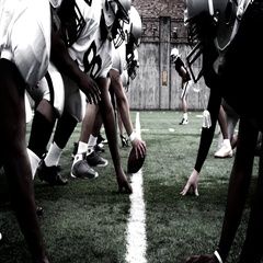 Football teams meet at the line of scrimmage Stock Footage