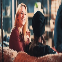 Young woman talking with man at bar 4k video. Couple blonde girl flirts guy Stock Footage