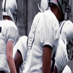 A Quarterback makes adjustments at the line of scrimmage before he hikes the bal Stock Footage