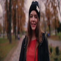 Cute European teenage girl in a black hat, backpack, leather jacket with long Stock Footage