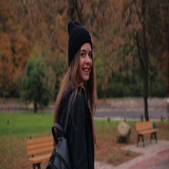 Amazing happy girl in a stylish rock casual look walks cross the autumn city Stock Footage