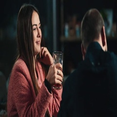 Young woman with beverage talking with man at bar 4k video. Girl flirts guy Stock Footage