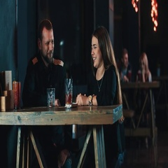 Couple date at bar 4k video. Young woman man with beverage talking Stock Footage