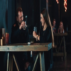 Couple date toast cheers drink cocktails at bar 4k video. Woman man smiling Stock Footage