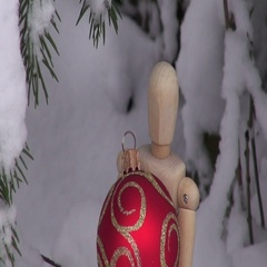 Wooden artist models with Christmas baubles Stock Footage