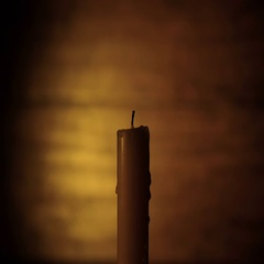 The Hand Lights a Candle on the Dark Brown Background Stock Footage