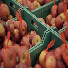 Fresh fruits in a market. Apples in boxes in supermarket Stock Footage