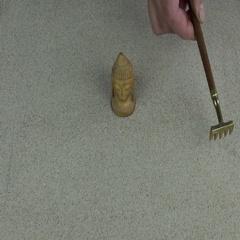Man making zen garden with mini rake on sand Stock Footage