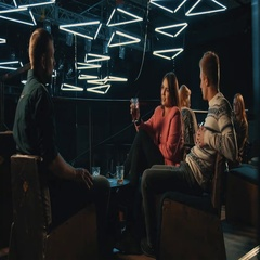 People sitting at bar night club 4k video. Friends talking drink beverage Arkistovideo