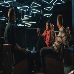 People sitting at bar night club 4k video. Friends talking drink beverage Stock Footage