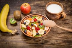 Healthy nutrition background with oatmeal and fruits Stock Photos