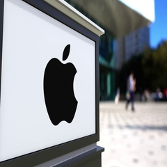 Street signage board with Apple Inc. logo. Blurred office center and walking Stock Footage