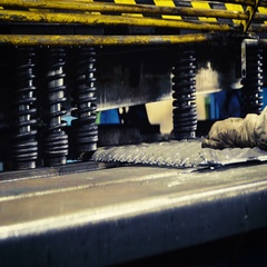 Machine is cutting sheet metal in automobile factory Arkistovideo