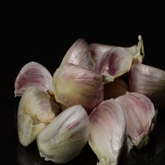 Garlic cloves on black background Stock Footage