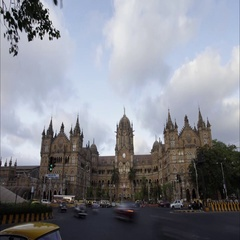 Time lapse shot of (V.T.) CST Station building lit up at evening, Mumbai, India. Stock Footage