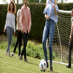 Adult friends having fun with a football on a playing field Stock Footage