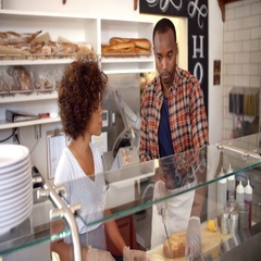 Black couple working behind the counter at a sandwich bar Stock Footage