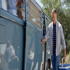 Family packing up their camper van for a road trip vacation Stock Footage
