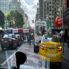 Busy street behind taxi cab tour bus Broadway and 5th Ave sign Manhattan NYC Stock Footage