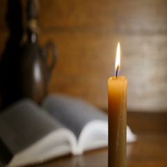 Old Rare Holy Book With Candles in Front Stock Footage