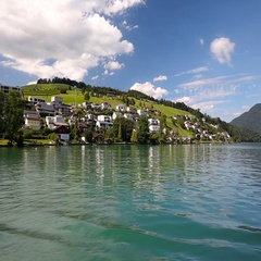 Swiss landscape from boat with houses and Swiss Alps, Switzerland, Europe. Stock Footage
