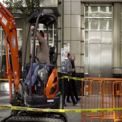 Passing construction site with bulldozer and workers in NYC Stock Footage
